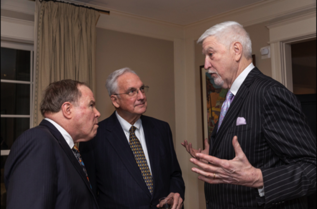 (L to R) Former undersecretary of the Army Joe Reeder and former congressmen Bob Livingston and Tom McMillen engrossed in discussion.