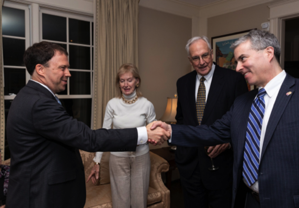 Andrew Marble greets AUSA editor Joe Craig, as former congressman Bob Livingston and wife Bonnie look on.